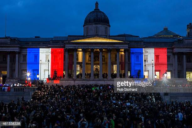 The National Gallery is lit in the blue white and red colours of the national flag of France in tribute to the victims of the terrorist attacks in...