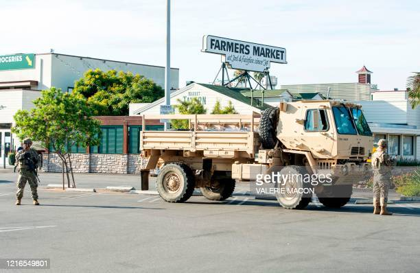 The National Guard are stationed in front of the Farmers Market on 3rd and Fairfax, on May 31 in Los Angeles, California. - Clashes broke out and...