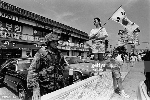 The National Guard at the Korean Pride Parade in Los Angeles following the 1992 riots that swept the city for days after three of four police...