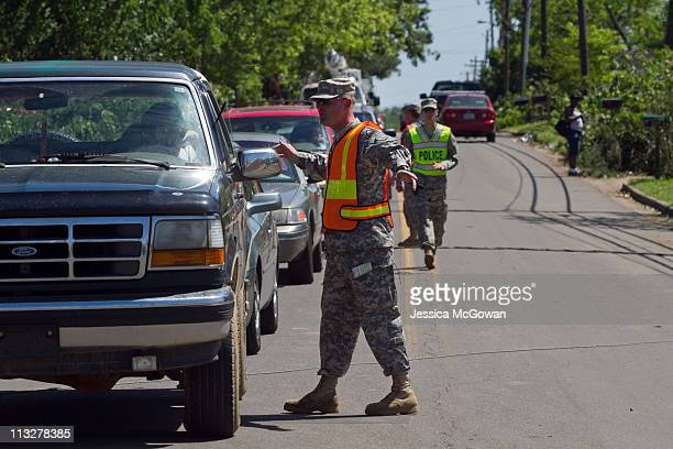 The National Guard directs traffic away from the most devastated areas on April 29, 2011 in Alberta City area of Tuscaloosa, Alabama. The tornado...