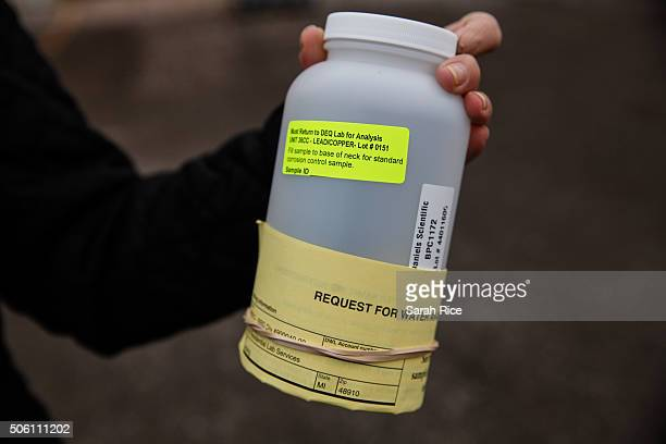 The National Guard hand out water testing jugs for residents at a fire station January 21 2016 in Flint Michigan The city's water supply hd been...