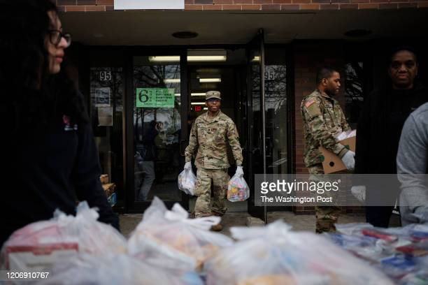 The National Guard sort groceries at a community center in New Rochelle New York on Thursday March 12 2020
