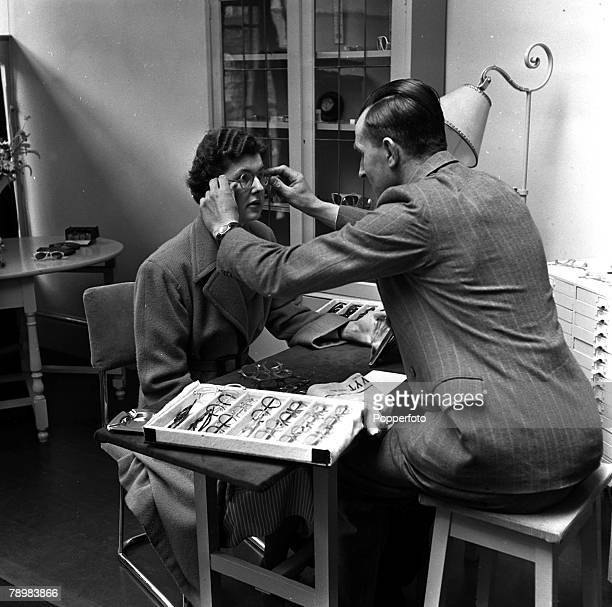The National Health Service at work in Portsmouth here a lady tries out her new glasses as eighteen million pairs have been supplied to the Health...