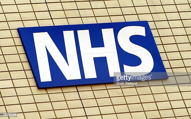 The National Health Service logo is shown on the wall outside St Thomas's Hospital May 7 2003 in London England Britain's Health Secretary Alan...