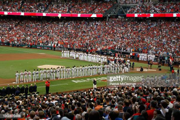 The National League AllStars and American League AllStars line up for the national anthem during the 89th MLB AllStar Game presented by Mastercard at...