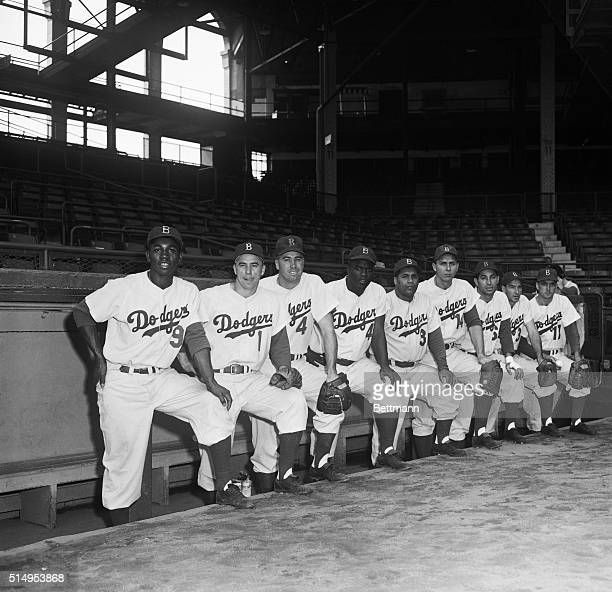 The National League champs who'll meet the Yankees in the 1953 Series opener September 30th form their starting lineup during a last minute workout...