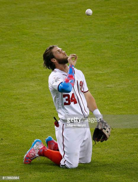 The National League's Bryce Harper of the Washington Nationals reacts after making a catch on a fly ball by American League catcher Salvador Perez of...