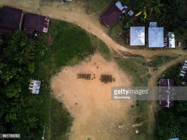 The National Liberation Army guerrillas stand in formation in an aerial photograph taken above a remote village in Choco Department Colombia on...