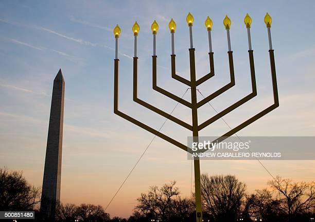 The National Menorah part of the Jewish holiday of Hanukkah is seen near the Washington Monument in Washington DC on December 10 2015 The holiday...