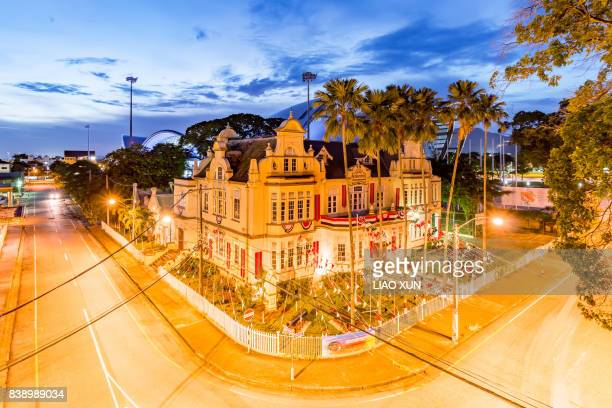 the national museum and art gallery of trinidad ang tobago with independence day's decoration, port of spain - port of spain stock photos and pictures