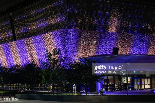 The National Museum of African American History & Culture stands illuminated in purple and gold at dusk on August 26, 2020 in Washington, DC. The...