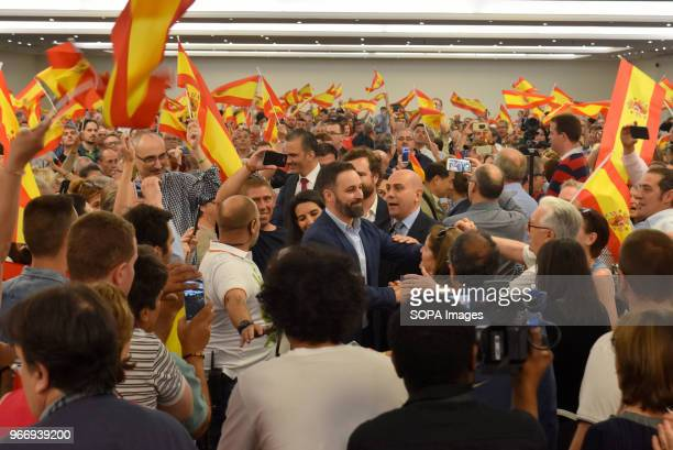 The National President of Vox Santiago Abascal greets his militants and supporters as they wave Spanish flags upon his arrival at the political...