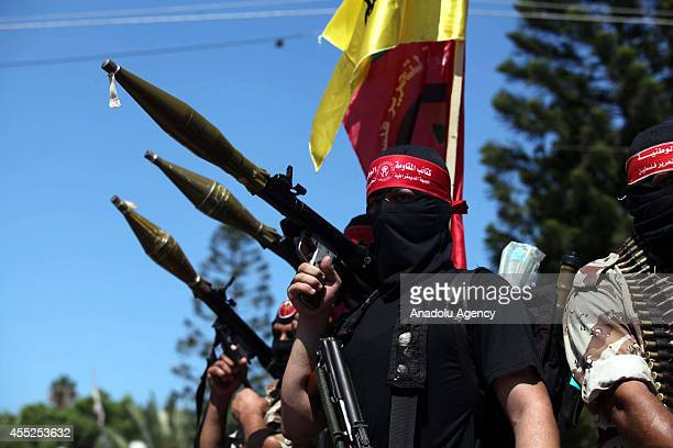 The National Resistance Brigades the armed wing of the Democratic Front for the Liberation of Palestine hold artilleries during a march for the...