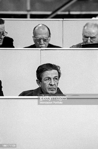 The national secretary of the Italian Communist Party a serious Enrico Berlinguer seated on the pews of the Palace of Sports monitors the works and...