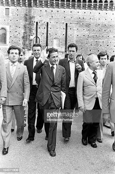 The national secretary of the Italian Communist Party Enrico Berlinguer greeting and walking at Festa dell'Unita in Parco Sempione Milan September...