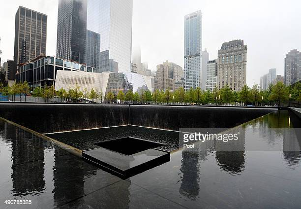 The National September 11 Memorial Museum stands beyond the north reflecting pool during the opening ceremony for the museum at ground zero May 15...