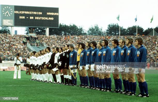 The national soccer teams of East and West Germany stand in files for the national anthems before the start of the 1974 World Cup soccer game East...