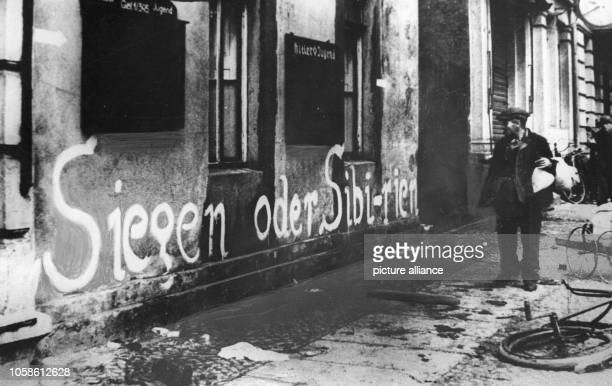 The National Socialist slogan Victory or Sibiria is pictured on a wall in Berlin at the start of 1945 With this slogan coined by Goebbels it was...
