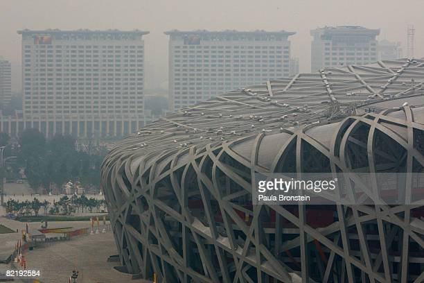 The National Stadium is seen shrouded in smog two days before the opening of the Beijing 2008 Olympic Games on August 6, 2008 in Beijing, China....