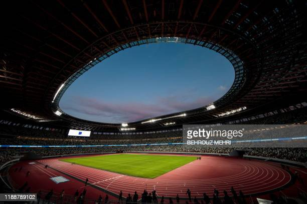 The National Stadium, venue for the upcoming Tokyo 2020 Olympic Games, is seen during a media tour following the the stadium's completion in Tokyo on...