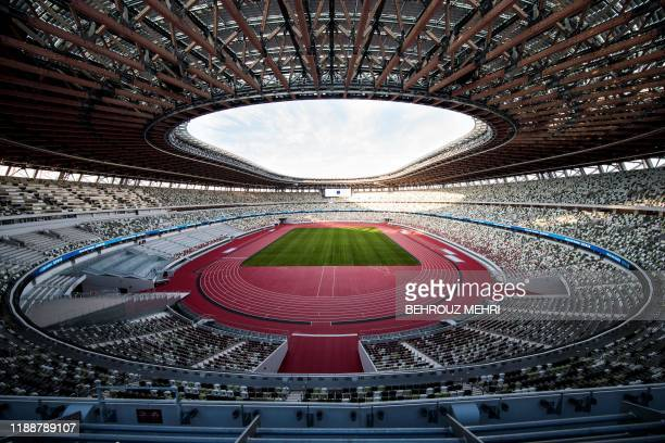 The National Stadium venue for the upcoming Tokyo 2020 Olympic Games is seen during a media tour following the the stadium's completion in Tokyo on...