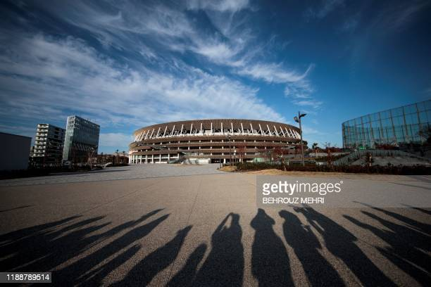 TOPSHOT The National Stadium venue for the upcoming Tokyo 2020 Olympic Games is seen during a media tour following the stadium's completion in Tokyo...