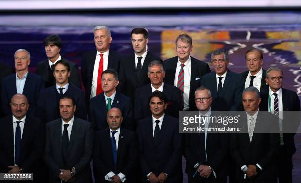 The national team managers pose for a photo during the Final Draw for the 2018 FIFA World Cup Russia at the State Kremlin Palace on December 1 2017...