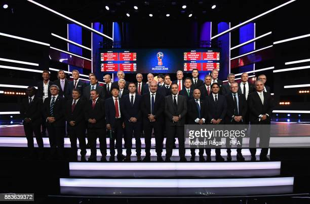 The National team managers pose for a photo on stage after the Final Draw for the 2018 FIFA World Cup Russia at the State Kremlin Palace on December...
