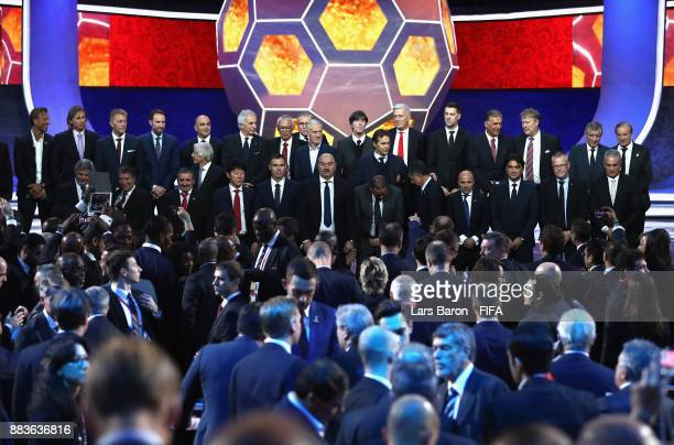 The National team managers pose for a photo on stage during the Final Draw for the 2018 FIFA World Cup Russia at the State Kremlin Palace on December...