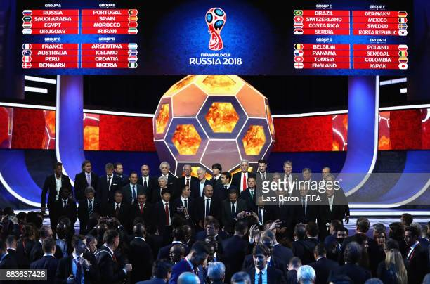 The national team managers pose for a photo on the stage during the Final Draw for the 2018 FIFA World Cup Russia at the State Kremlin Palace on...
