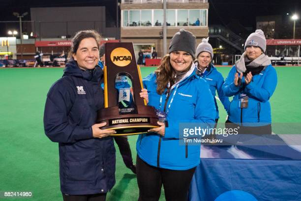 The national title trophy is presented to head coach Katharine DeLorenzo of Middlebury College during the Division III Women's Field Hockey...