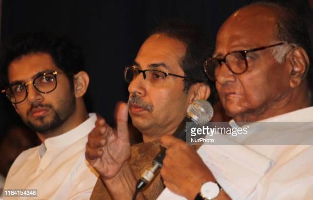 The Nationalist Congress Party chief, Sharad Pawar speaks as Shiv Sena chief, Uddhav Thackeray and his son Aditya Thackeray looks on during a press...