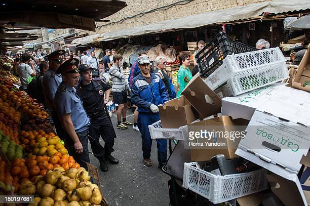 CONTENT] The nationalists held an action 'Russian cleanup' against illegal trading at the Sennoy market in historical center of St Petersburg Russia...