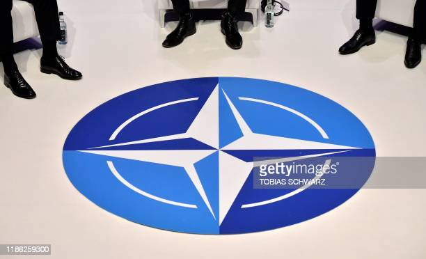 The Nato logo is pictured during a panel discussion at an official NATO outreach event, 'Nato Engages' in central London on December 3 prior to the...