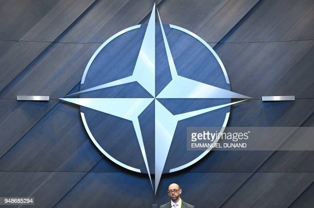 The NATO logo is pictured inside the new North Atlantic Council meeting room at the new NATO headquarters during a press tour of the facilities as...