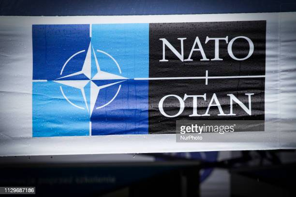 The NATO logo is seen at an exhibit at a military base in Bydgoszcz, Poland on March 9, 2019.