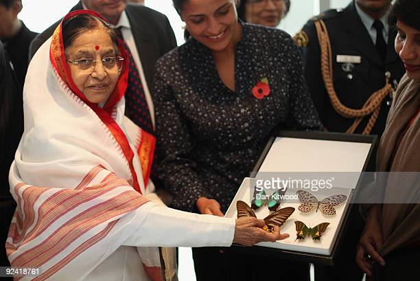 The Natural History Museums currator of Butterflies Blanca Huertas shows the President of the Republic of India Prathibha Devi Singh Patil a case of...