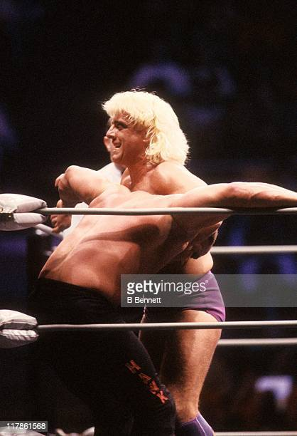 The Nature Boy Rick Flair gets ready to hit Road Warrior Hawk in the corner during their Heavy Weight bout at the 1988 Bunkhouse Stampede on January...