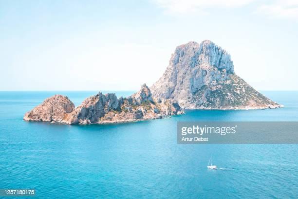 the nature reserve of es vedra island in front ibiza coast with beautiful blue colors. el paisaje de ibiza con la isla de es vedra. - seascape stock-fotos und bilder