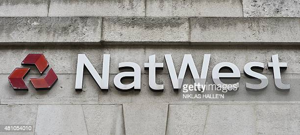 The NatWest logo is attached to the facade of a NatWest bank branch in central London on July 17, 2015. AFP PHOTO / NIKLAS HALLE'N
