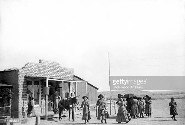 The Navajos are threatening to revolt aginst US rule but here the Navajo Indian girls are going shopping on a Saturday afternoon at the local trading...