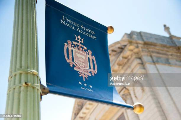 The Naval Academy crest is printed on a flag in front of the Naval Academy chapel on June 14 2018