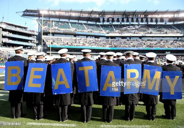 The Naval cadets march on the field before the game between the Army Black Knights and the Navy Midshipmen at Lincoln Financial Field on December 08...