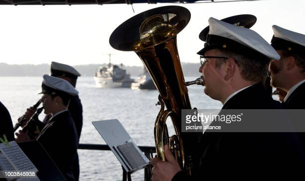 The naval vessels entering the port are welcomed with music by the navy music corps at the navy harbour in Kiel Germany 16 June 2017 More than 40...