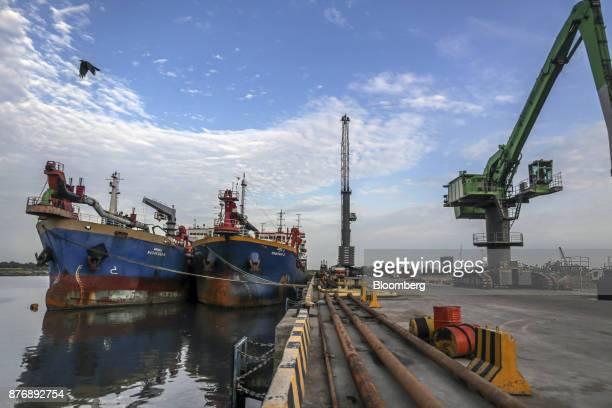 The Navayuga 6 left and the Navayuga 2 dredgers sit docked at Krishnapatnam Port in Krishnapatnam Andhra Pradesh India on Saturday Aug 12 2017 Growth...