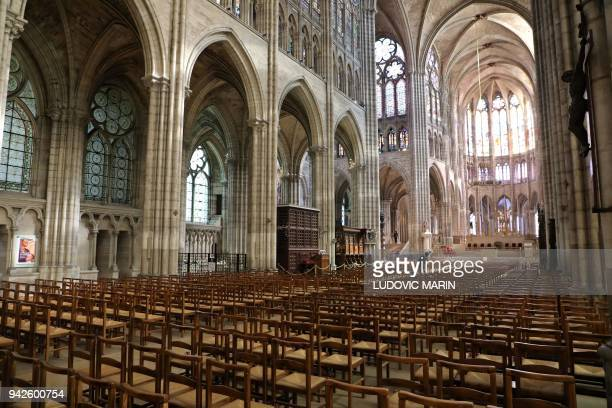 The nave and choir of the Saint-Denis basilica is pictured on April 6, 2018 in Saint-Denis, near Paris. / AFP PHOTO / Ludovic MARIN