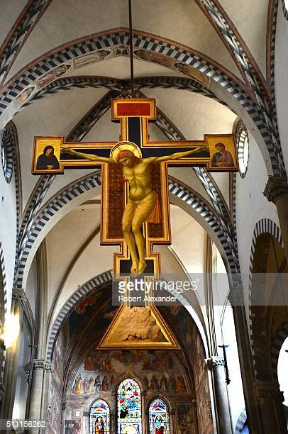 The nave at Santa Maria Novella in Florence Italy completed in 1360 features a crucifix painted by Giotto in circa 1290
