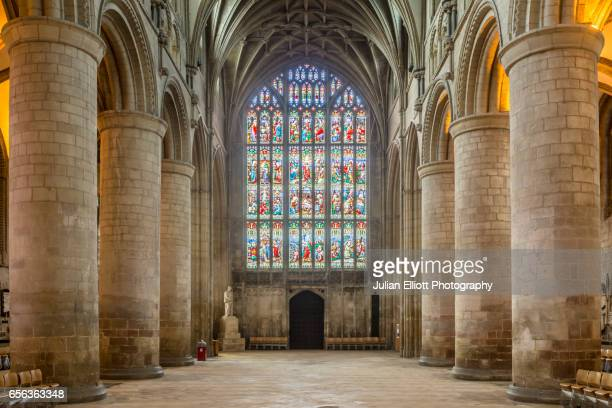 the nave of gloucester cathedral. - column stock pictures, royalty-free photos & images
