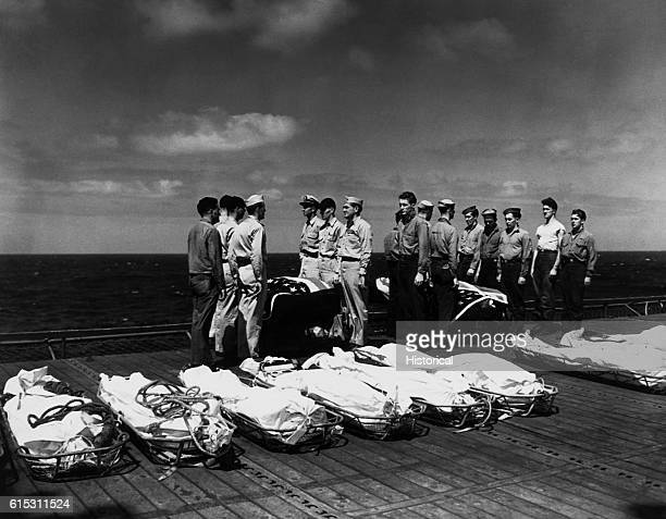 The Navy buries its dead at sea from the USS Lexington after being attacked by a Japanese kamikaze plane ca 19411945 | Location aboard the USS...