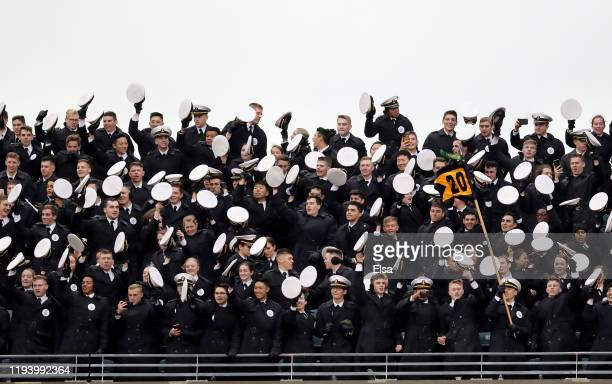 The Navy Midshipmen celebrate during the game against the Army Black Knights at Lincoln Financial Field on December 14 2019 in Philadelphia...